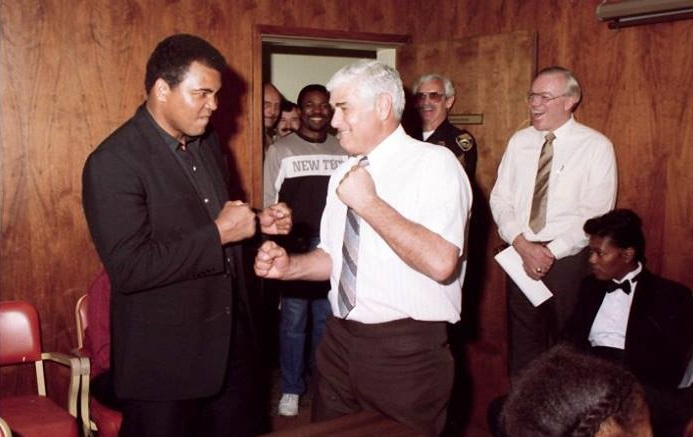 Muhammad Ali at SPD in 1987 sparring with Police Chief Julio Cecchetti.